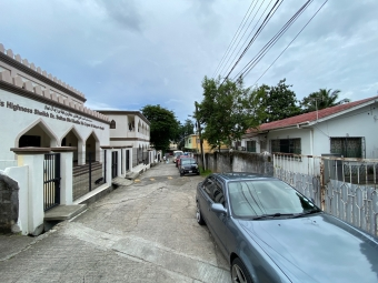 House on right, mosque to the left